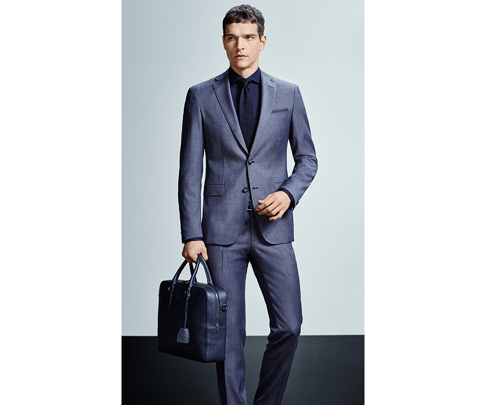 Blue BOSS suit and a blue business bag