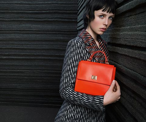 Red BOSS Womenswear dress and black bespoke bag