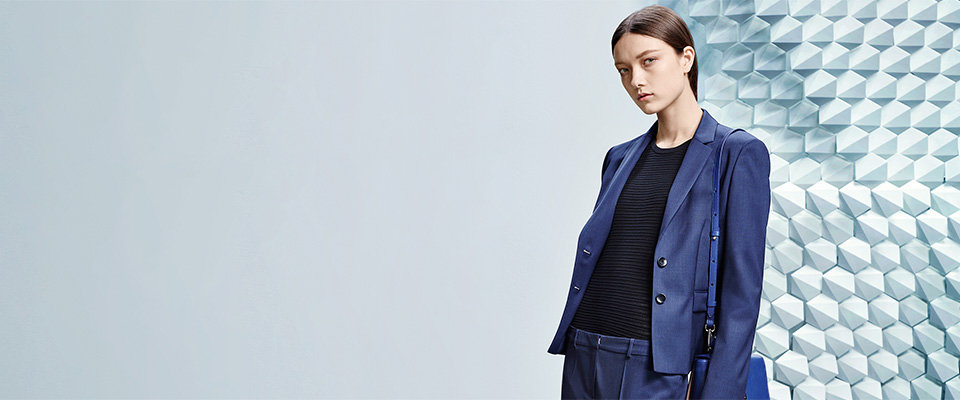 BOSS blazer and trousers in blue, black sweater and blue bespoke bag