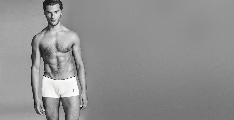 Model with white HUGO BOSS boxershorts with black tuck.