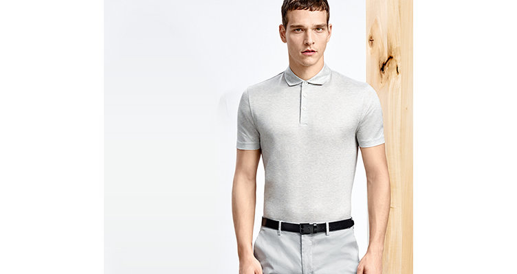 Models in different positions with grey and grey-white striped polos, grey trousers and black belt.