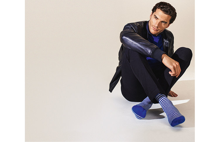 Model with blue-white striped HUGO BOSS socks. Combined with black-blue casual outfit.