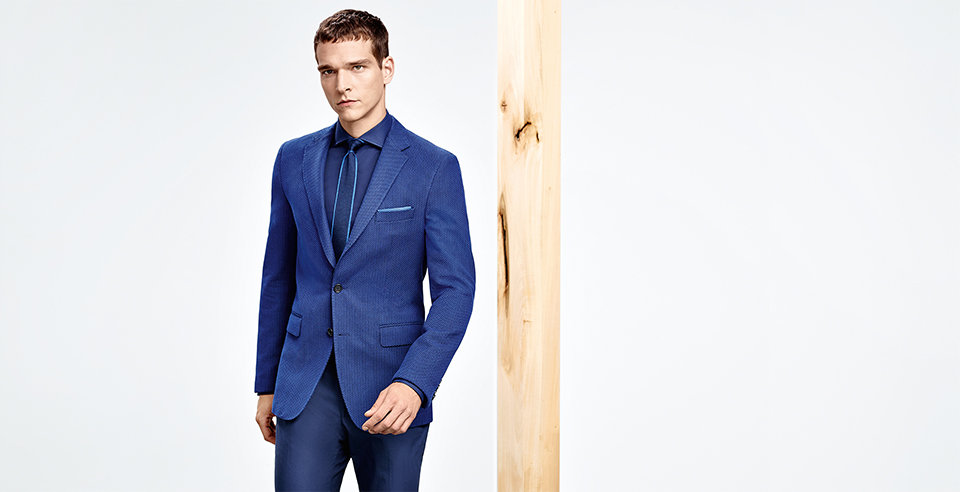 Model with blue HUGO BOSS suit. Tone in tone with blue shirt and tie with lightblue highlights.