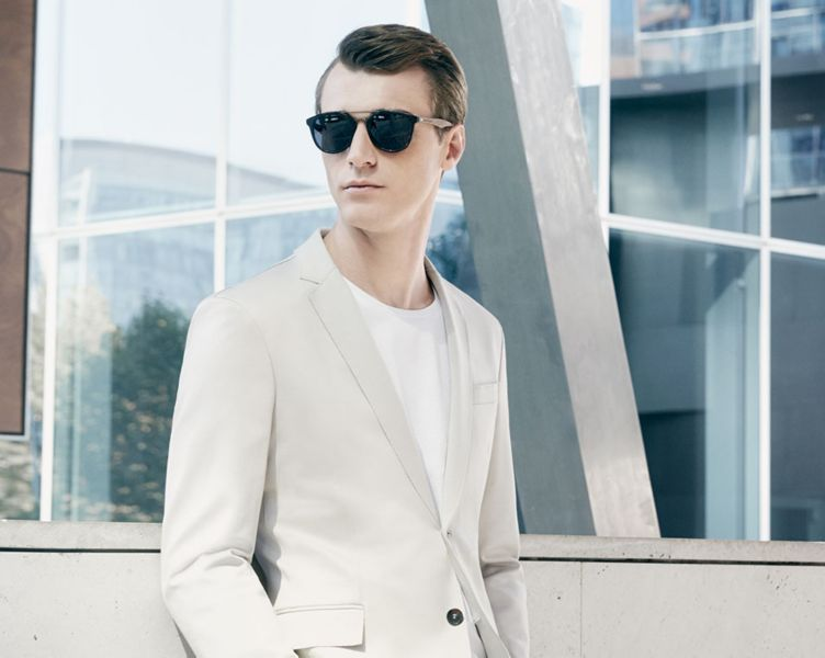 Beige coat, white jersey and white trousers by BOSS