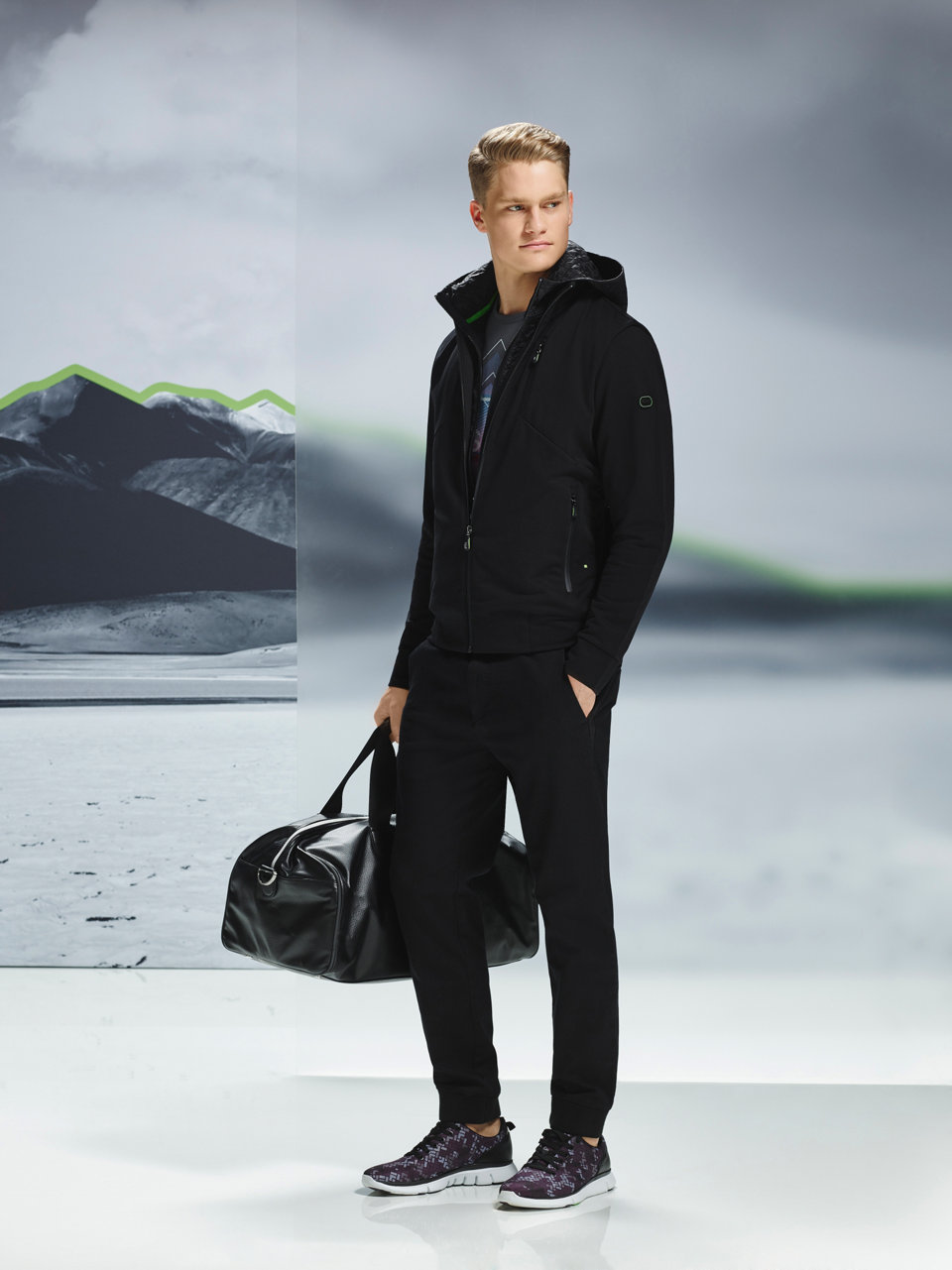 Black outerwear, black jersey, black trousers and black shoes by BOSS Green
