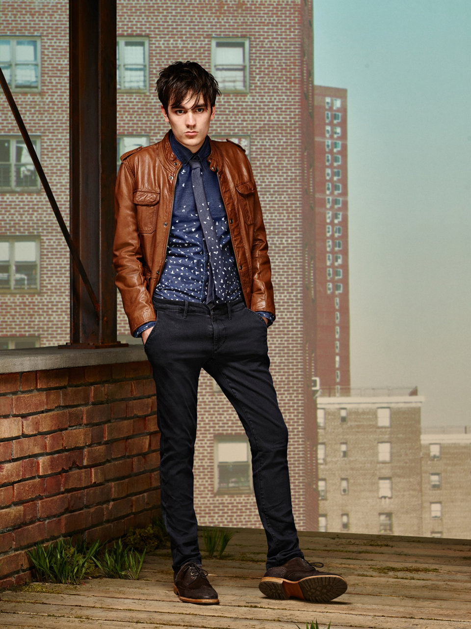 Brown leather jacket, dark blue patterned shirt, dark blue jeans and dark brown shoes by BOSS Orange