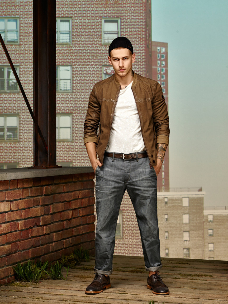 Leather jacket in khaki, white T-shirt, grey jeans, brown belt and dark brown shoes by BOSS Orange