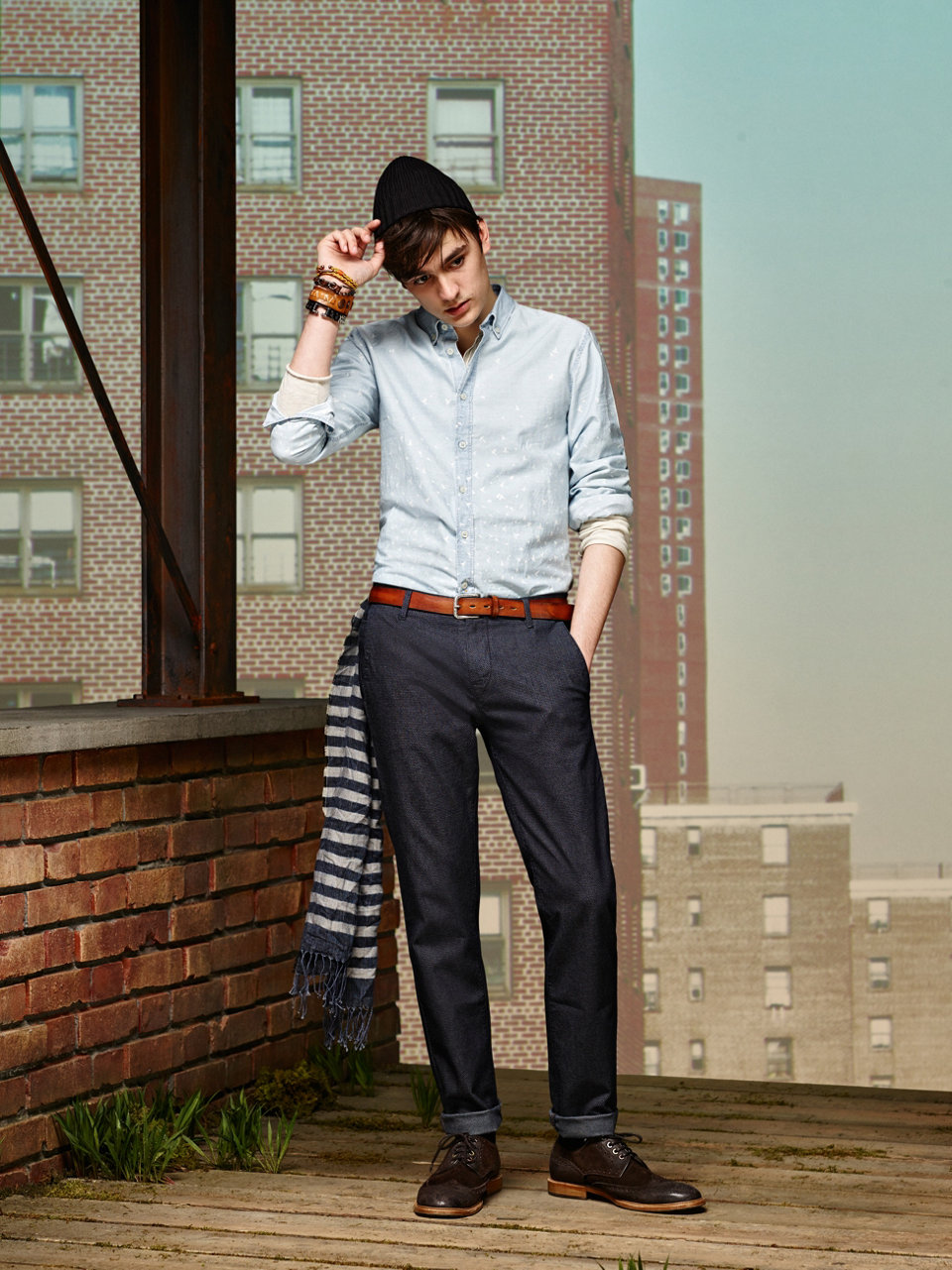 Light blue shirt, dark blue trousers, patterned sweater, brown belt and dark brown shoes by BOSS Orange