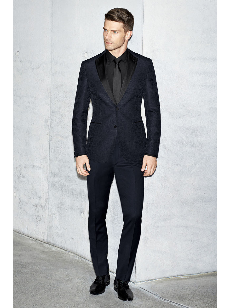 Dark blue tailored jacket, black shirt and black tie by BOSS