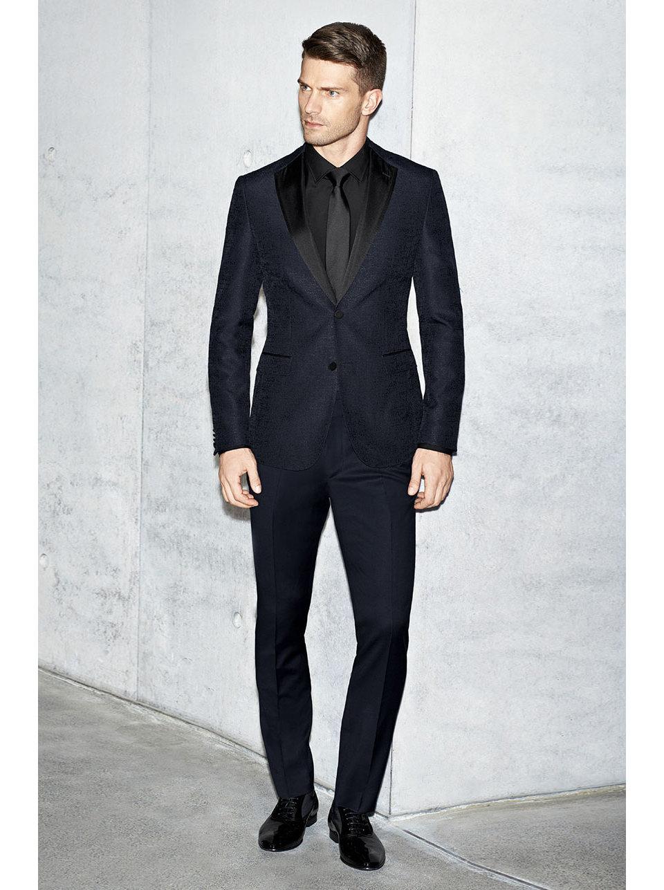 Dark blue tailored jacket, black shirt and black tie byBOSS