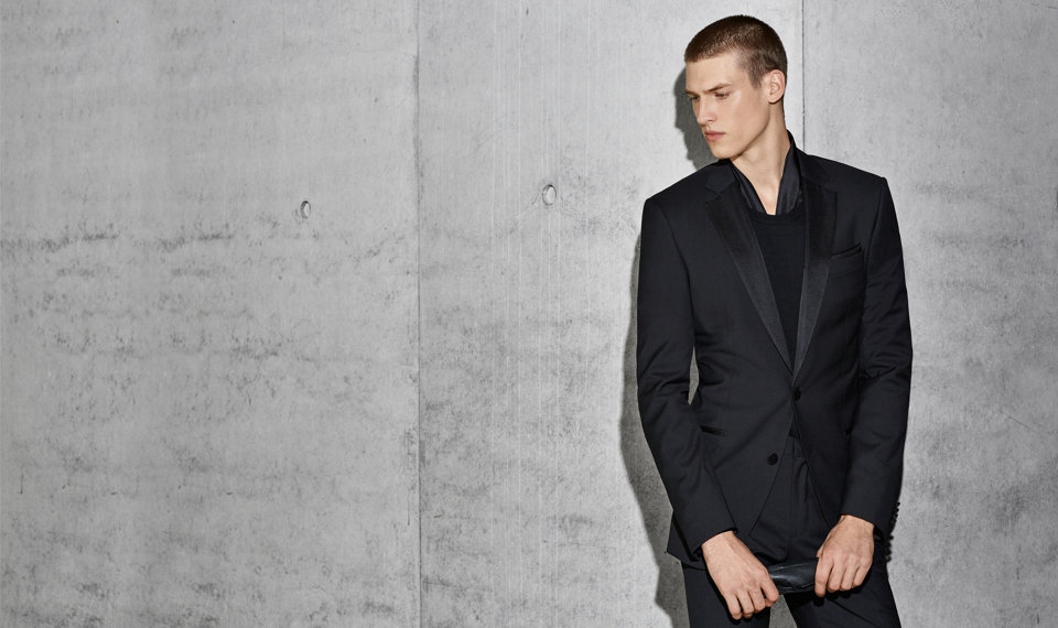 The model wears a black BOSS suit