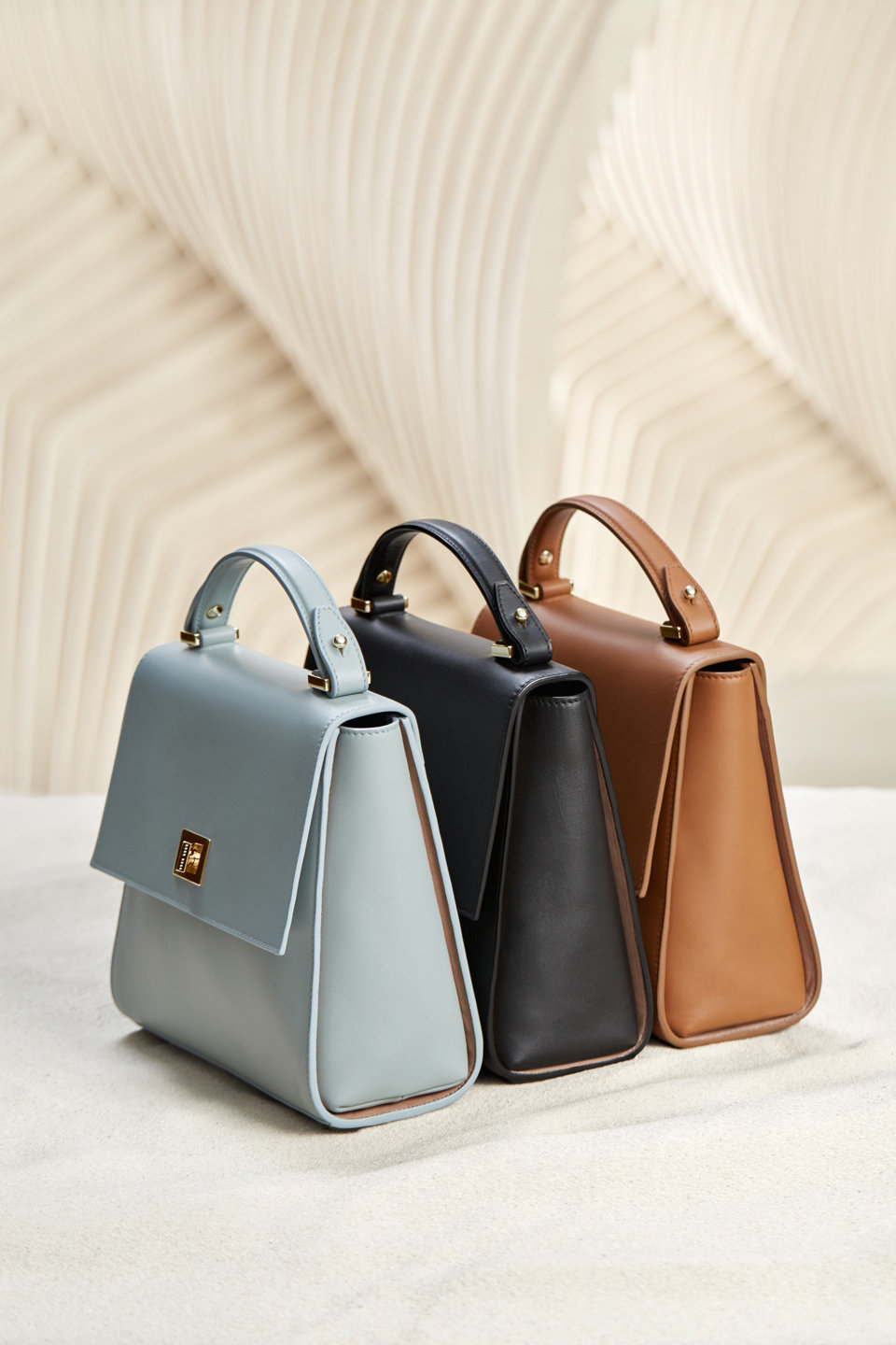 Leather bags in light blue, black and brown by BOSS