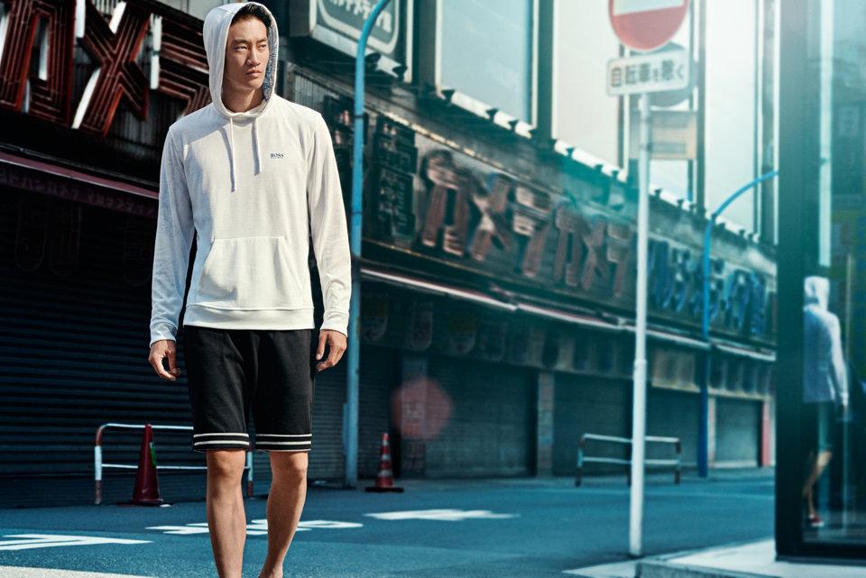 White sweatshirt and black shorts byBOSSGreen