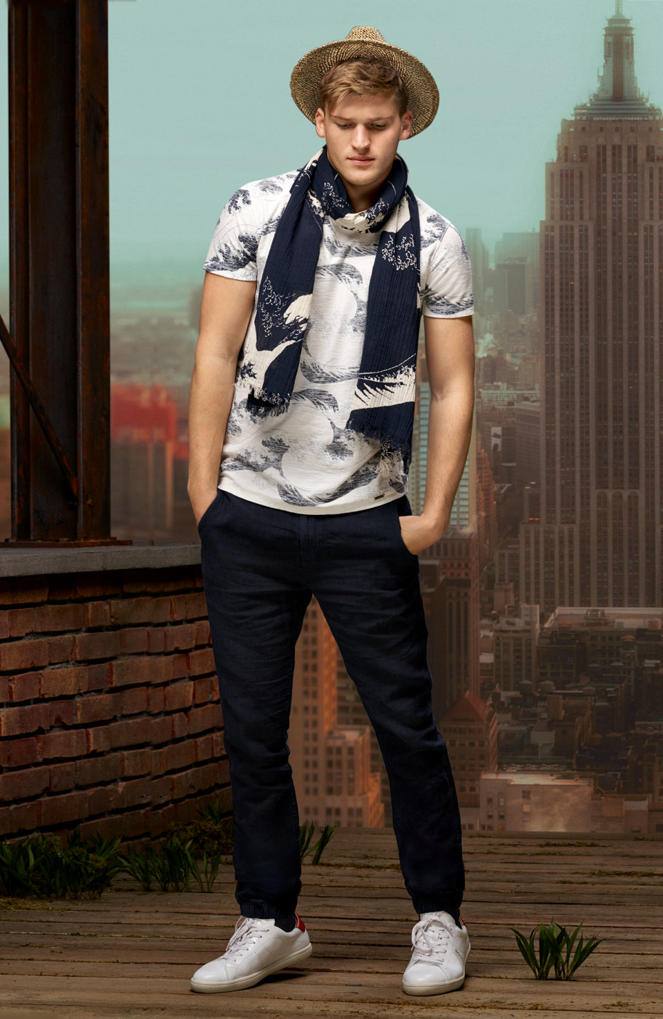 Print shirt, dark blue jeans, hat and patterned scarf by BOSS Orange