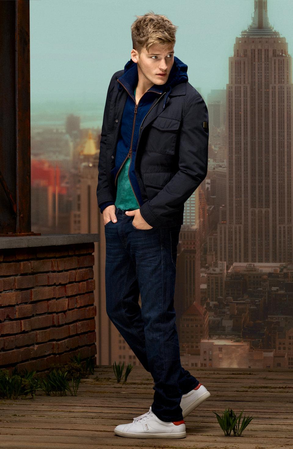 Dark blue outerwear, dark blue sweater and blue jeans byBOSSOrange