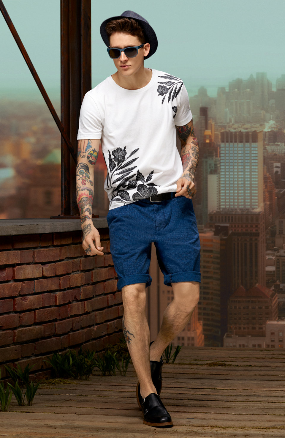 Print t-shirt, dark blue shorts, dark straw hat and black shoes by BOSS Orange