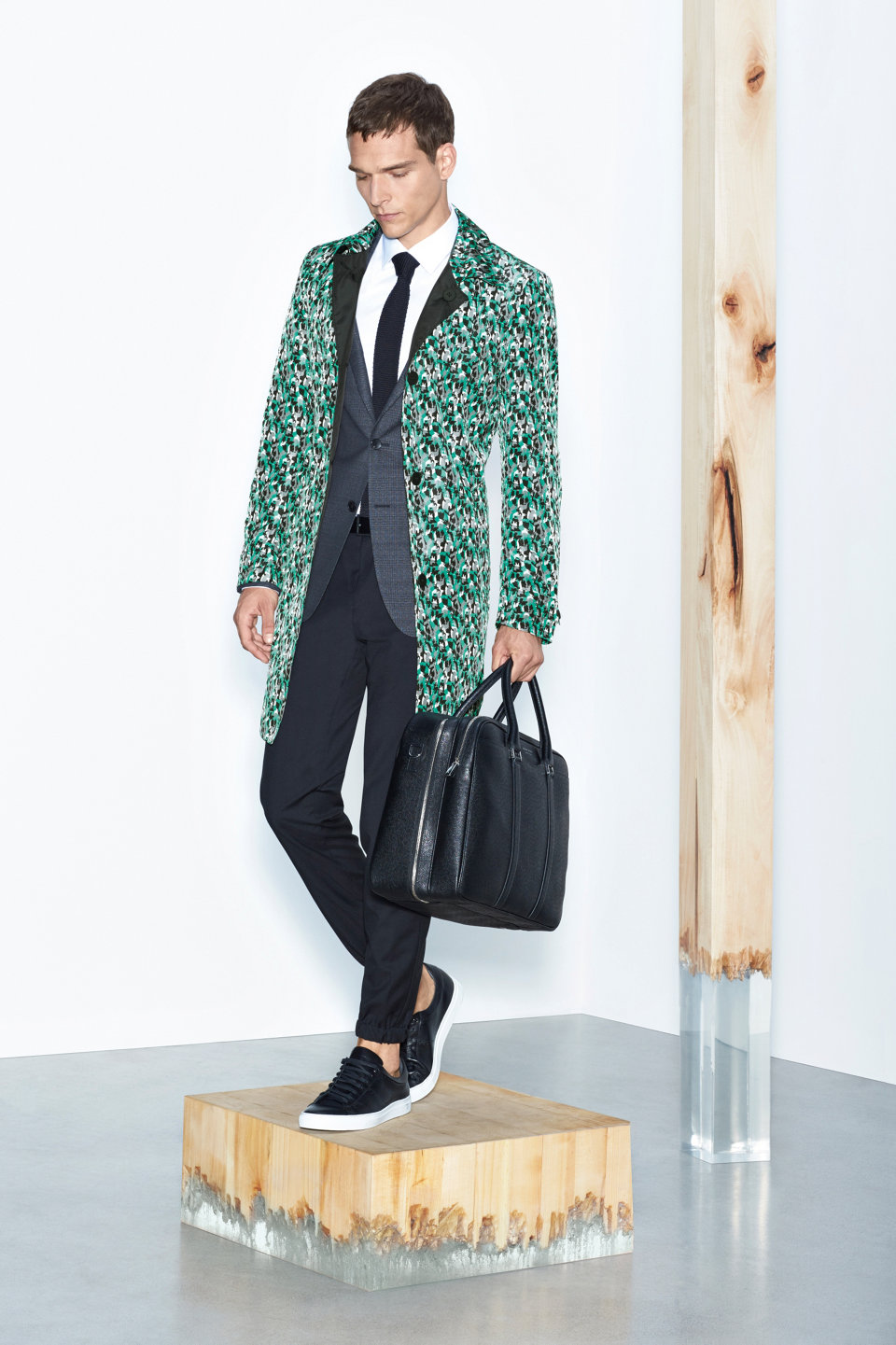 Patterned coat, black trousers and black leather bag by BOSS