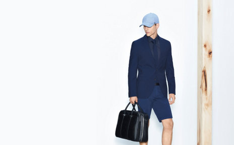Model with sportive HUGO BOSS baseball cap. Tinged with lightblue. Combined with darkblue suit.