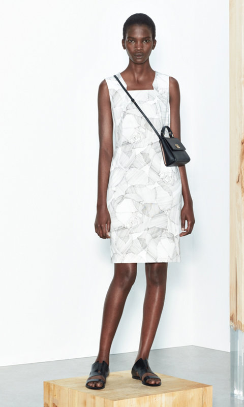White dress and black micro bespoke bag by BOSS