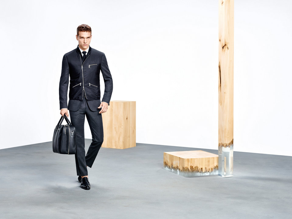 Black jacket, black suit and black leather bag by BOSS