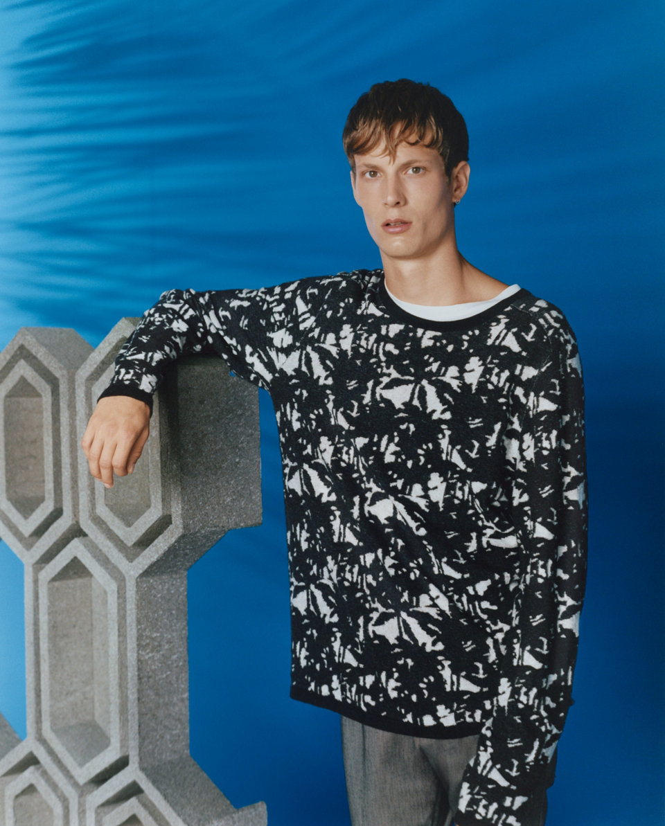 Print sweater and grey trousers by HUGO