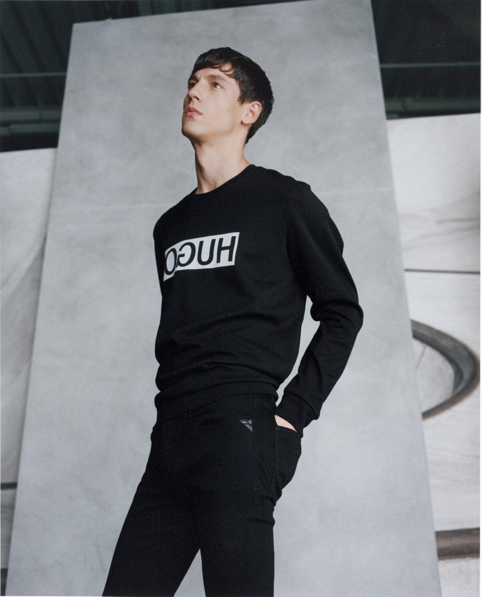 Black sweatshirt and black trousers byHUGO
