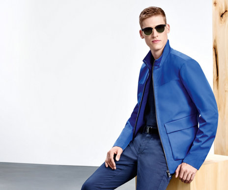 Model with blue HUGO BOSS blouson. The jacket has a band collar and patch pockets.