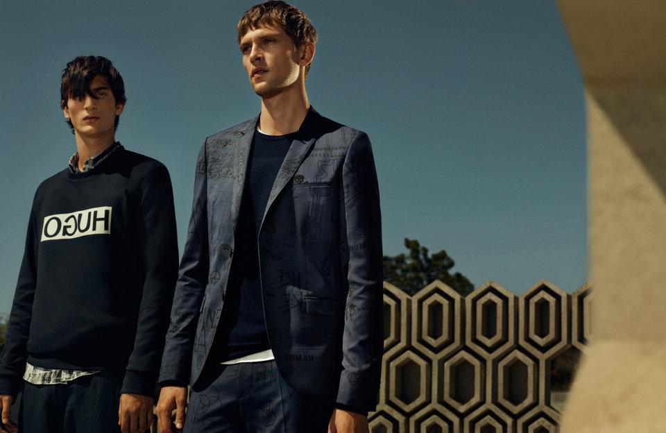 Black sweatshirt, dark blue suit and dark blue sweater byHUGO