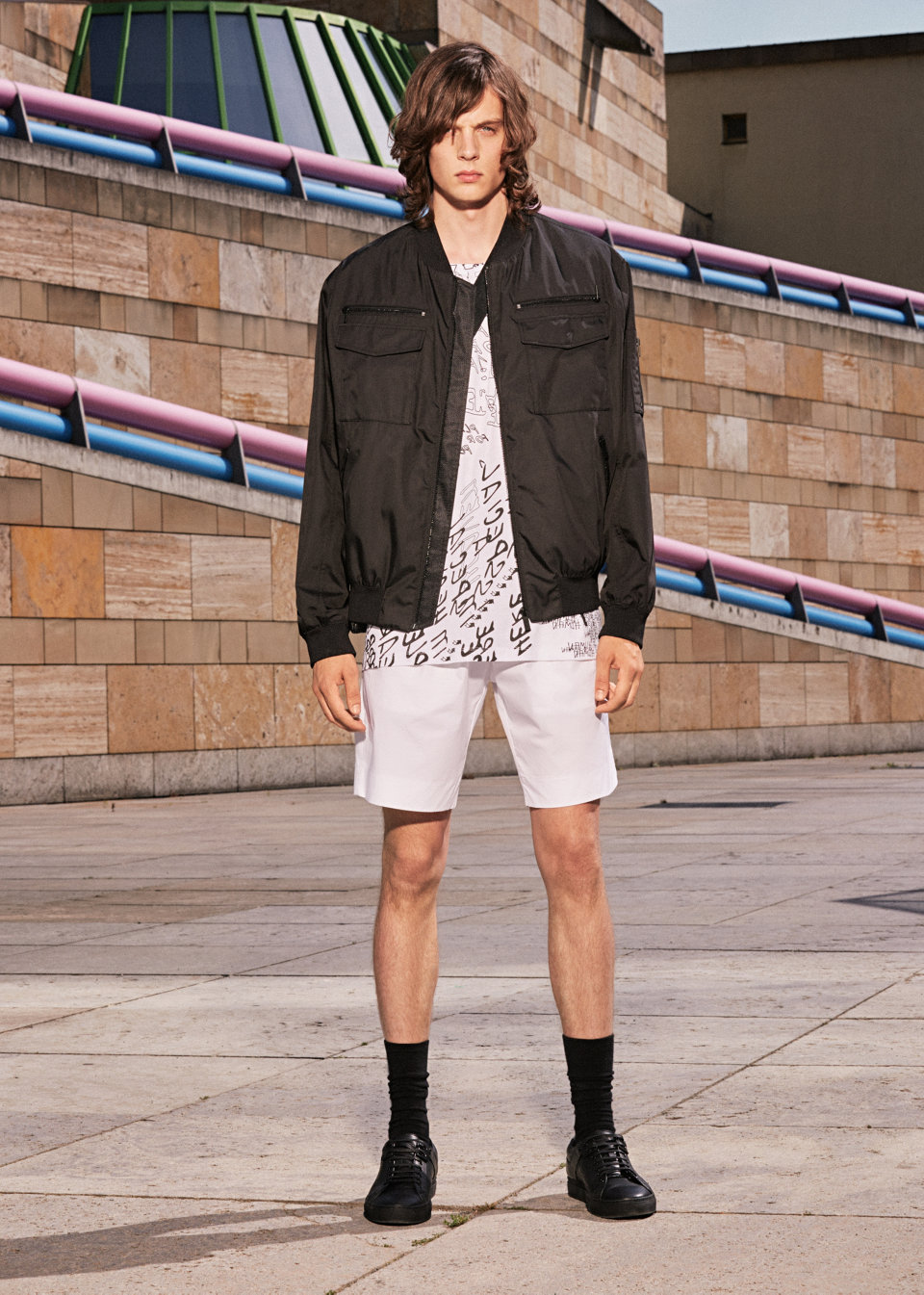 Black jacket, white t-shirt and white trousers byHUGO