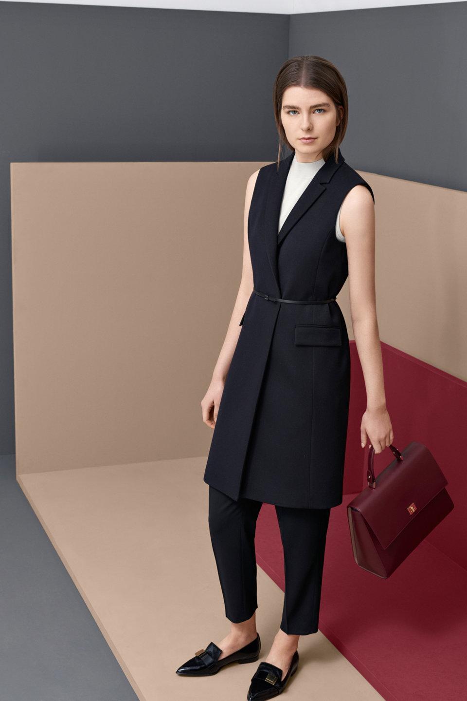 Black vest with a black leather belt.