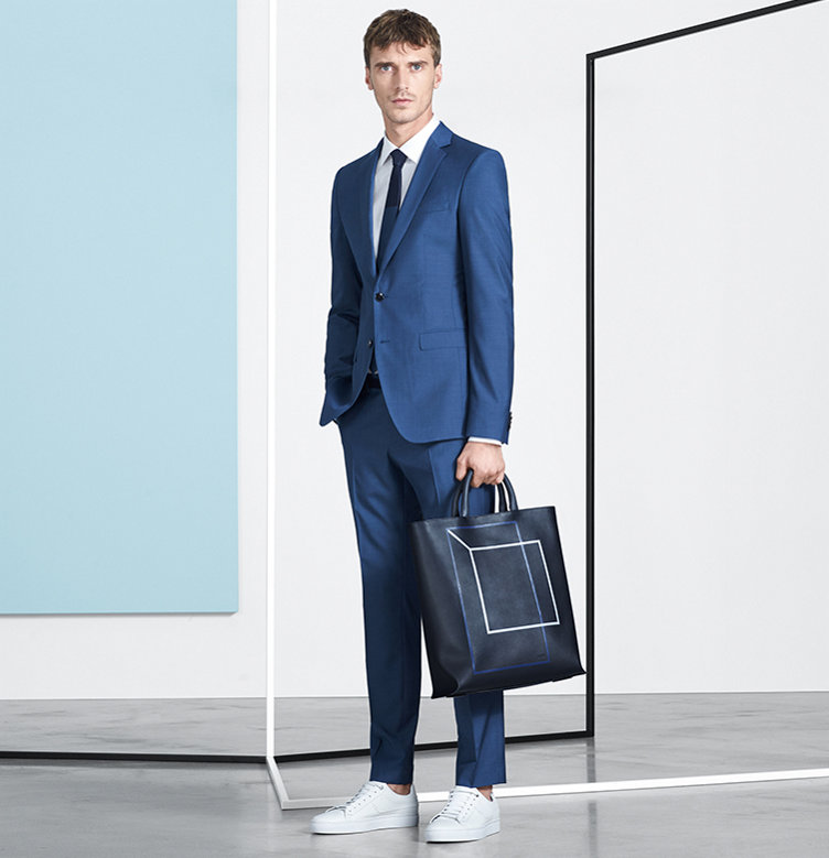 Turquoise suit, dark blue bag and white shoes by BOSS