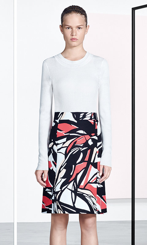 White knitwear and patterned skirt by BOSS