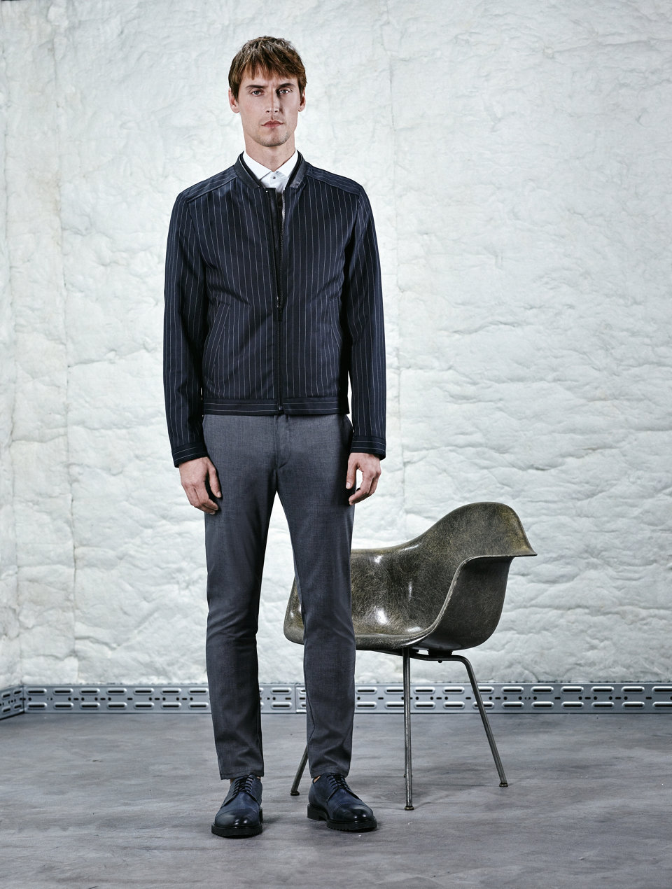 Dark grey pinstripe bomber jacket paired with grey trousers.