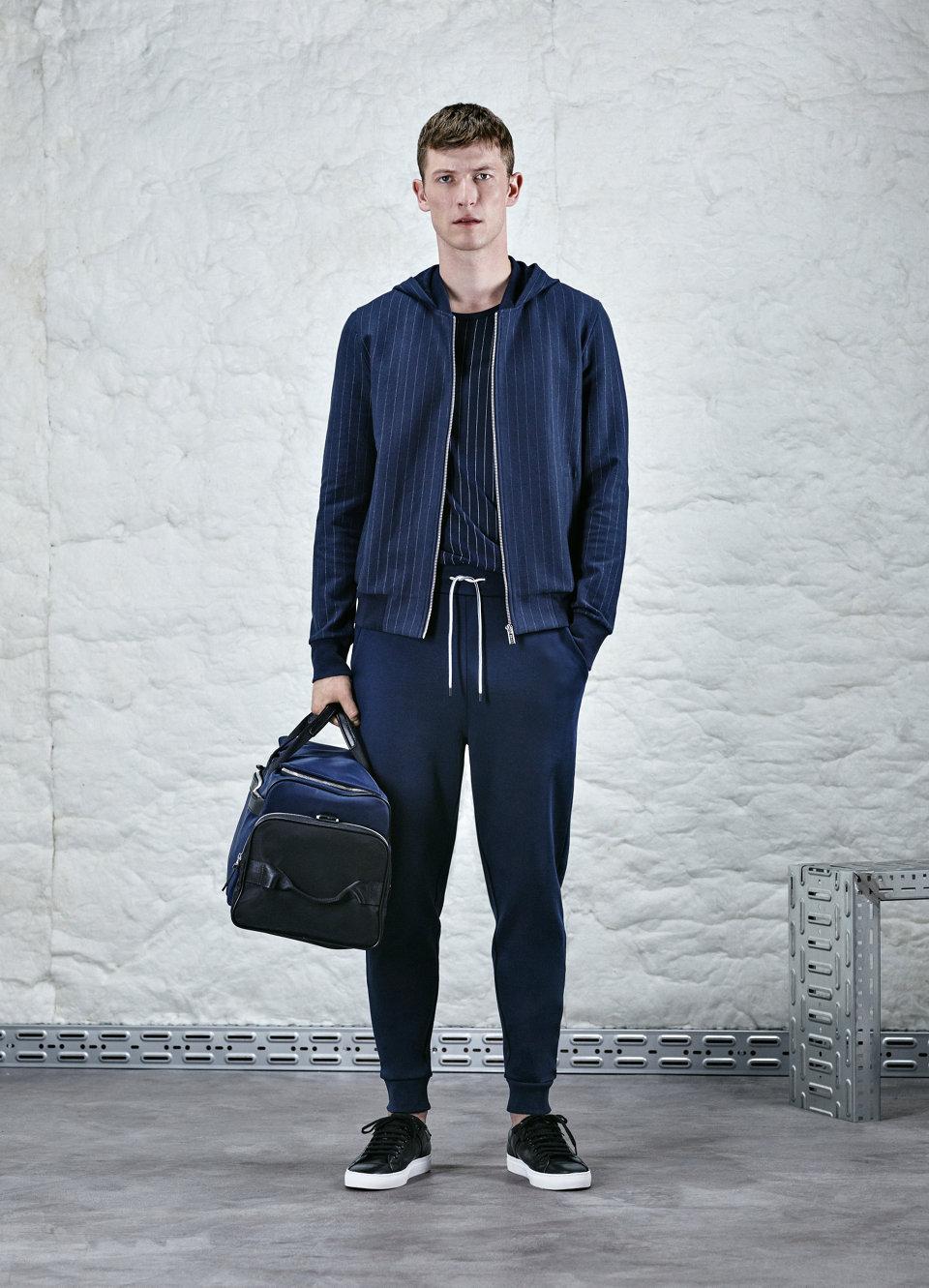Dark blue pinstripe zip-up jacket.