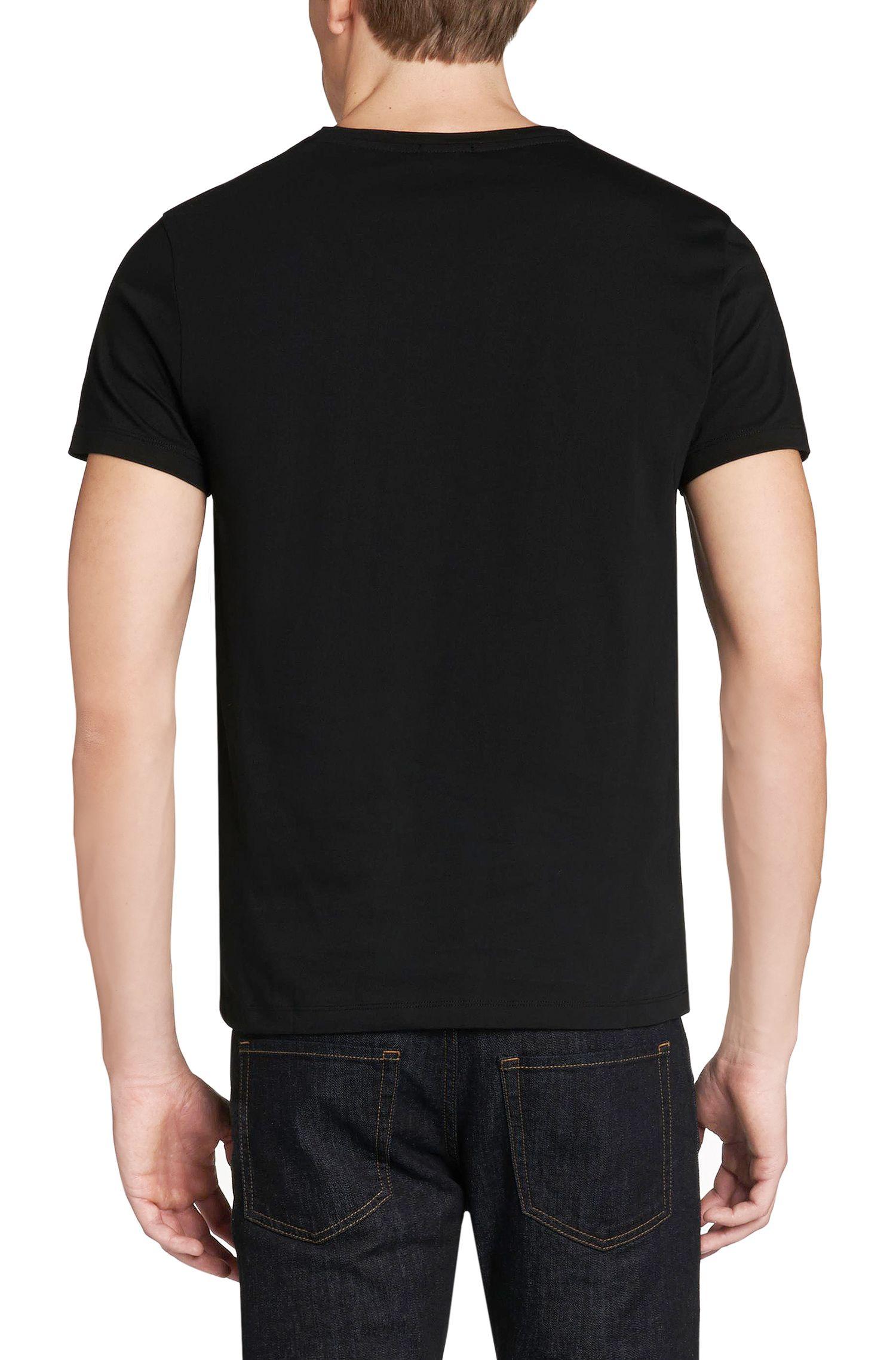 T-shirt uni en coton: «Canistro80»