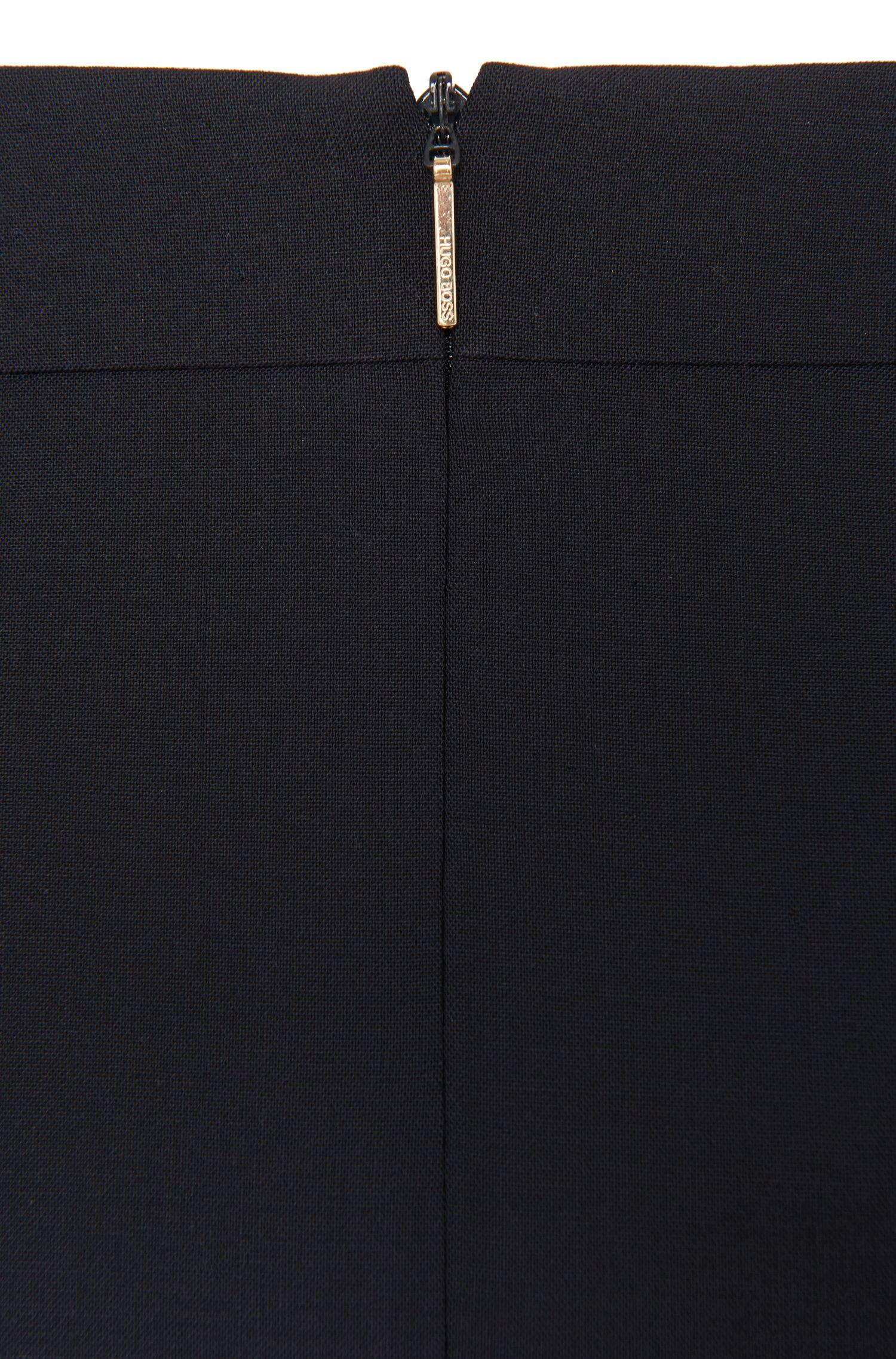 Jupe crayon à taille étroite, en laine vierge stretch. «Vilea»
