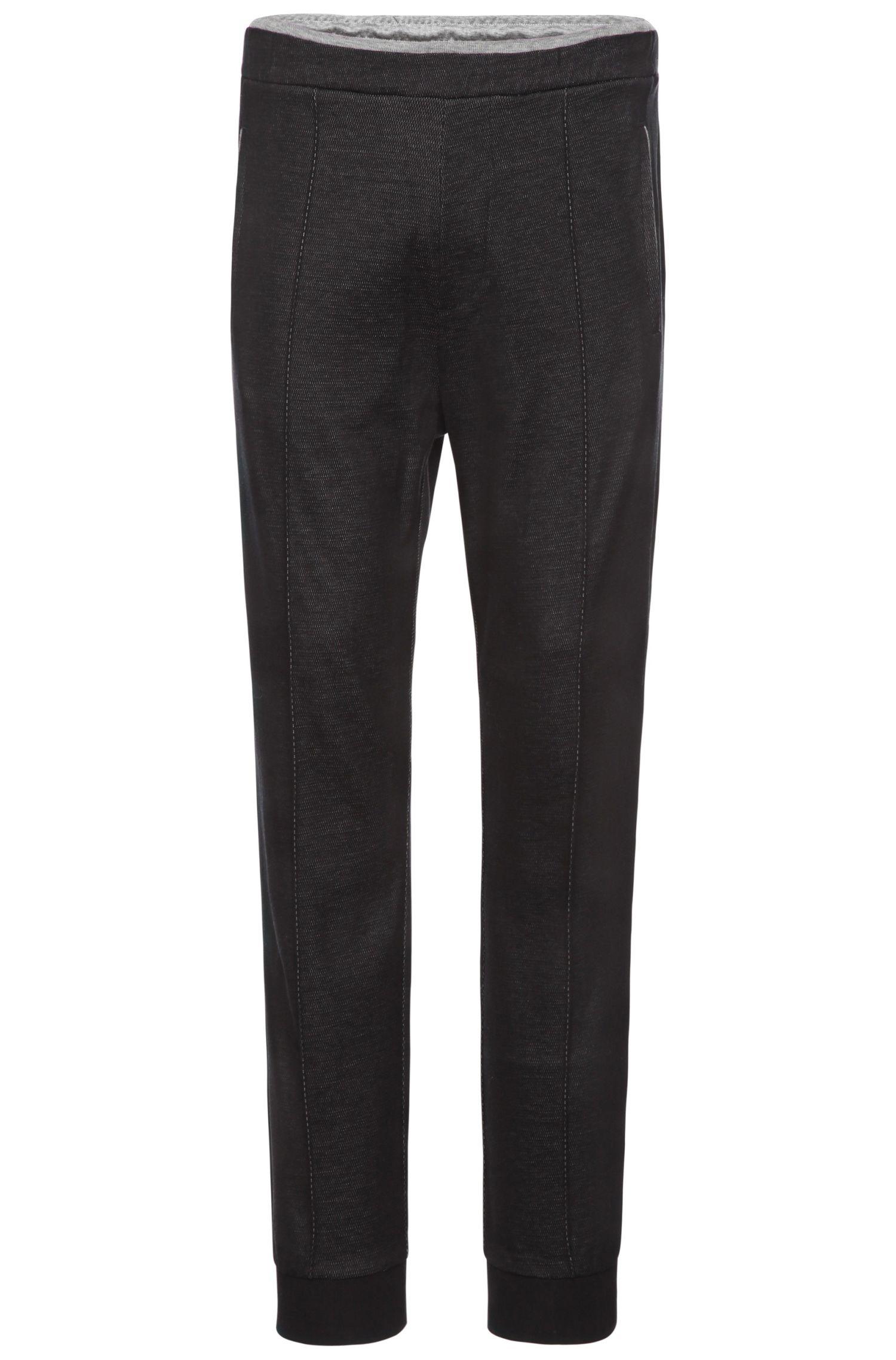 Pantalon de jogging en coton texturé: «Hajus»