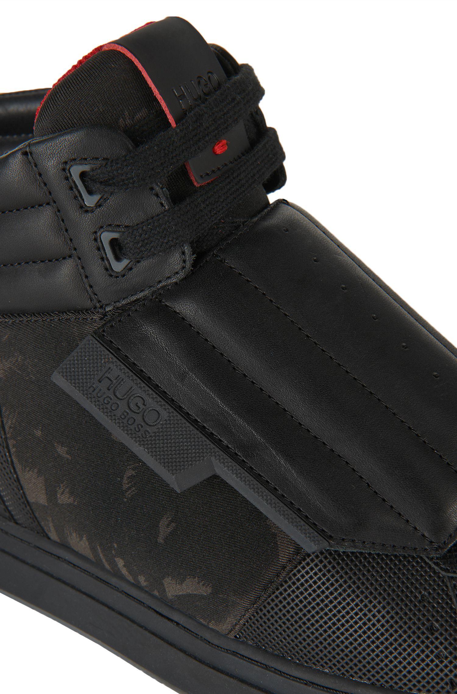 Enkelhoge sneakers met leren garneersel: 'Transk V'