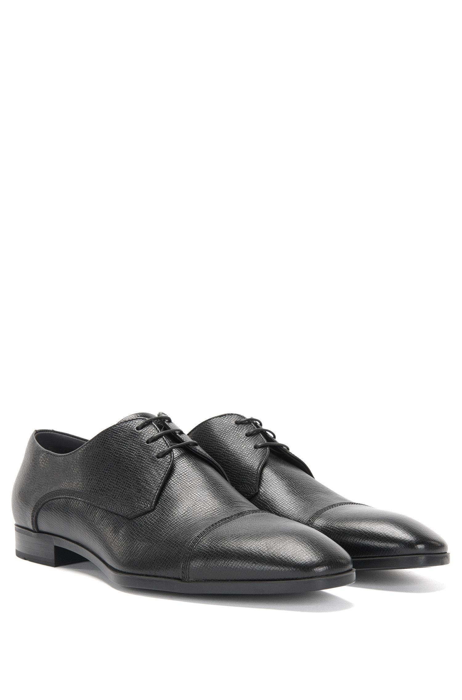 Chaussures à lacets gravées en cuir, au design contrastant sur le devant: «Underb»