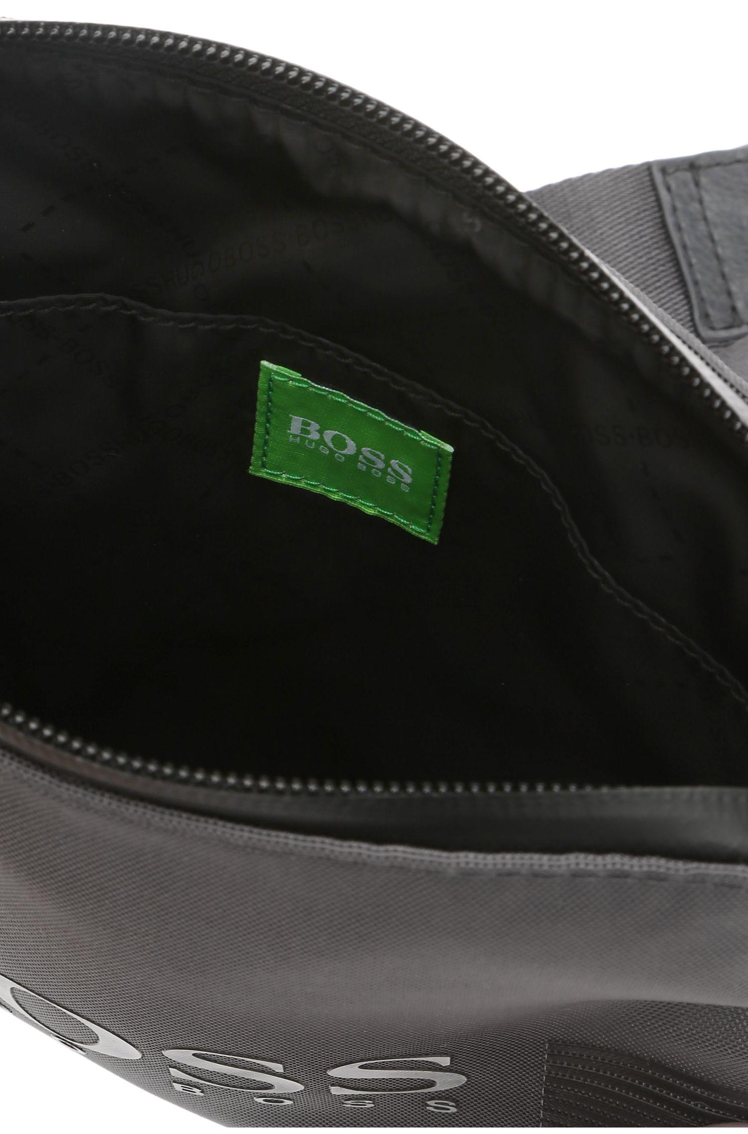 Minibag van een materiaalmix met garneersels in leerlook: 'Pixel_S zip env'