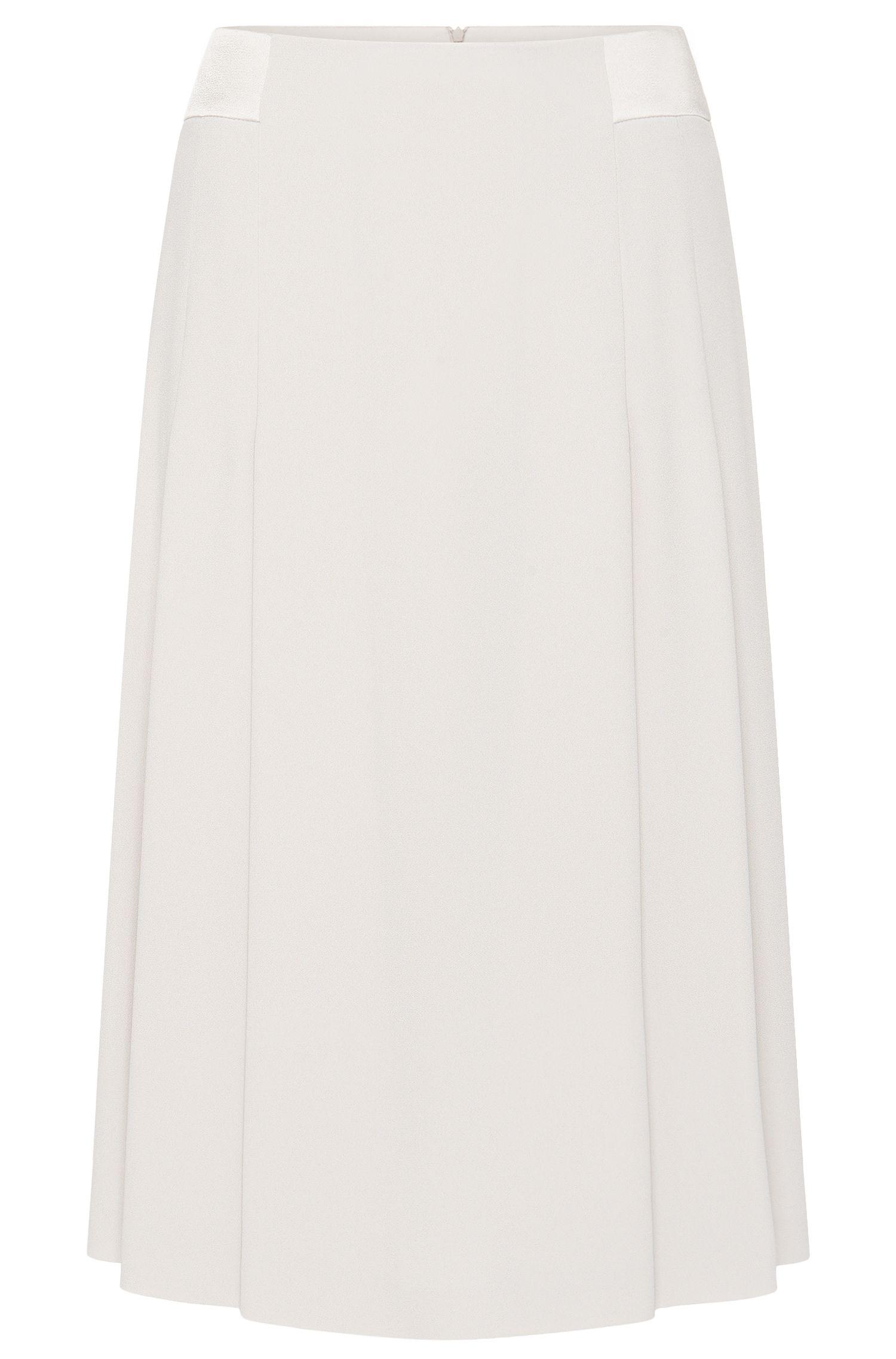 Mini-jupe unie à la coupe évasée: «Vibella»