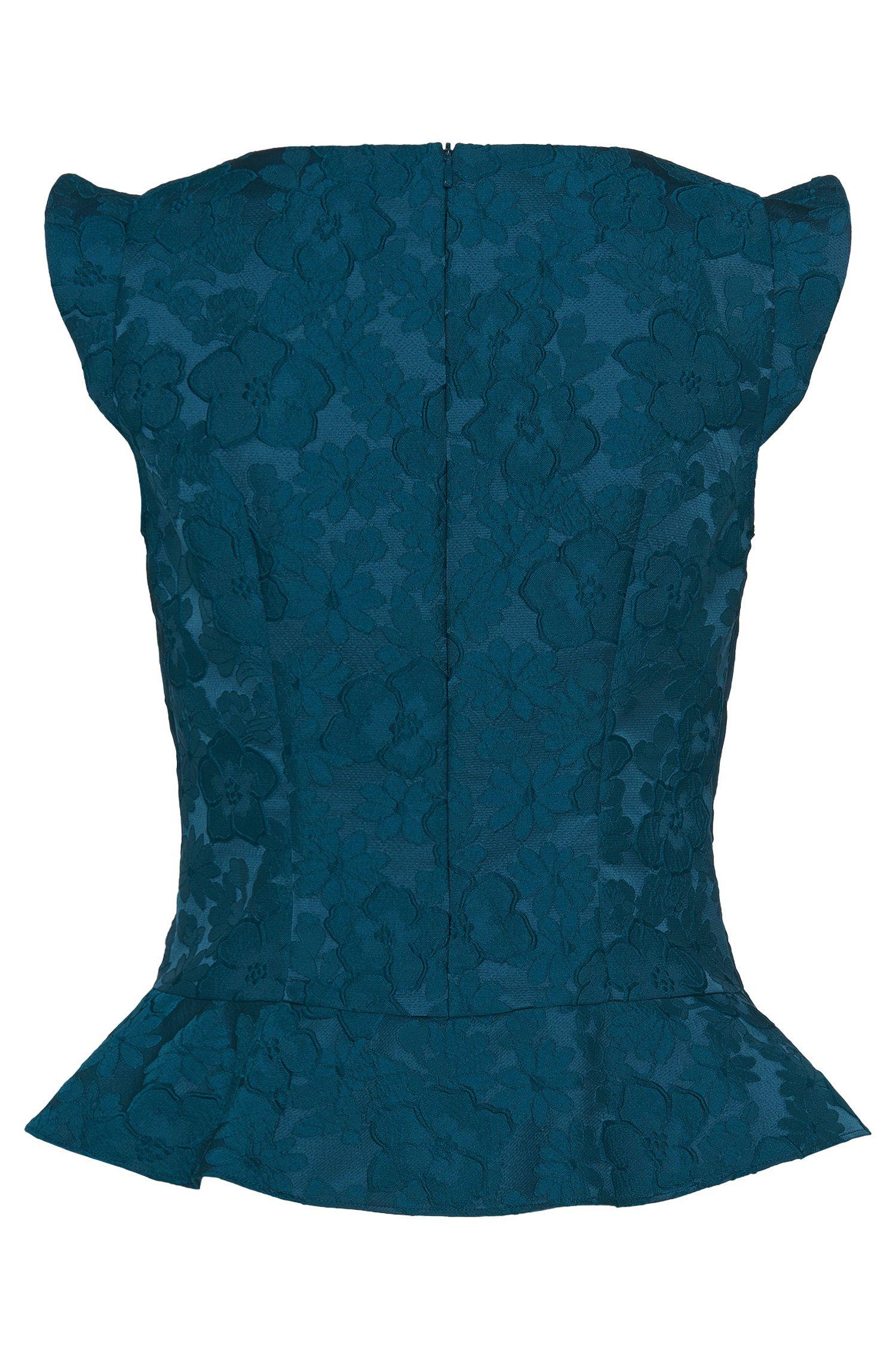 Top met schootje van een elastische stof: 'Carasai'