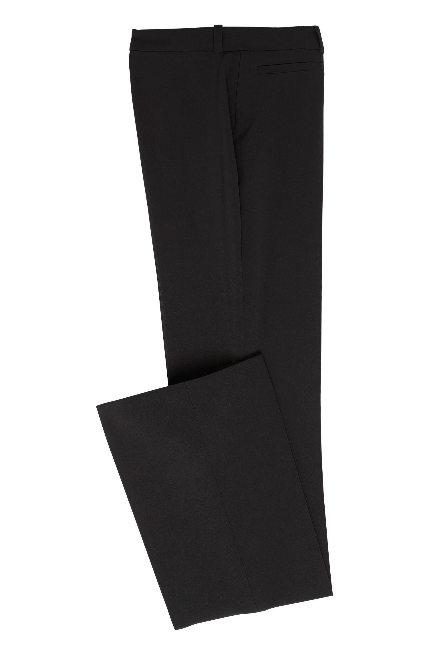 Iets uitlopende broek van een effen materiaalmix: 'Heddas'
