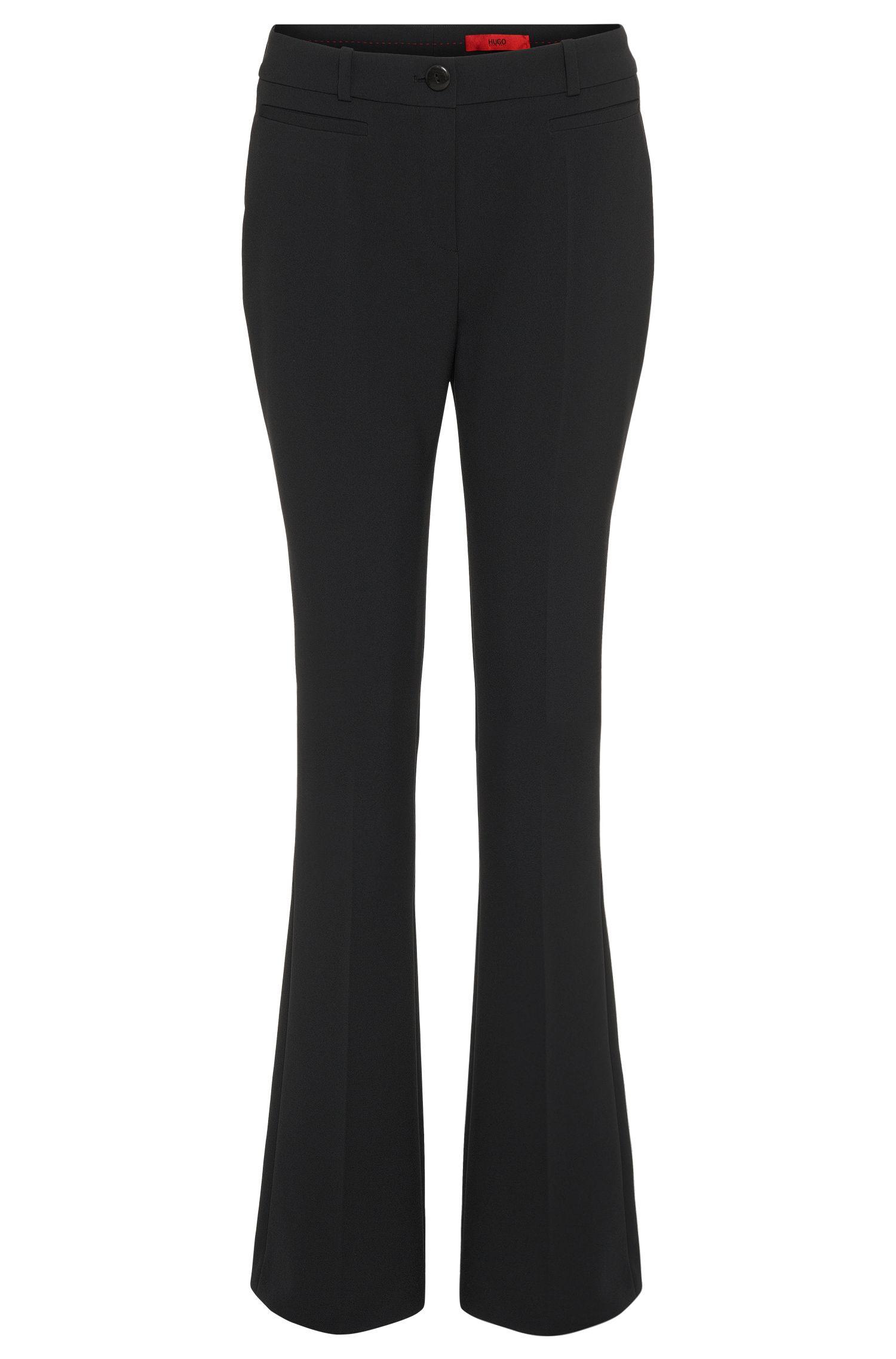 Pantalon légèrement évasé en mélange de matières uni: «Heddas»