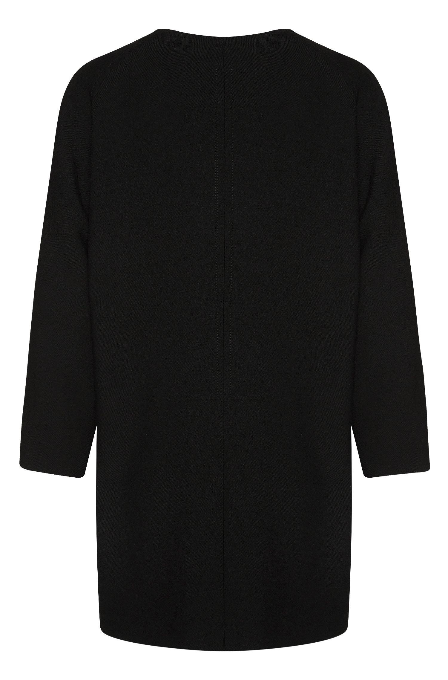 Manteau uni à patte de boutonnage invisible: «Calera»