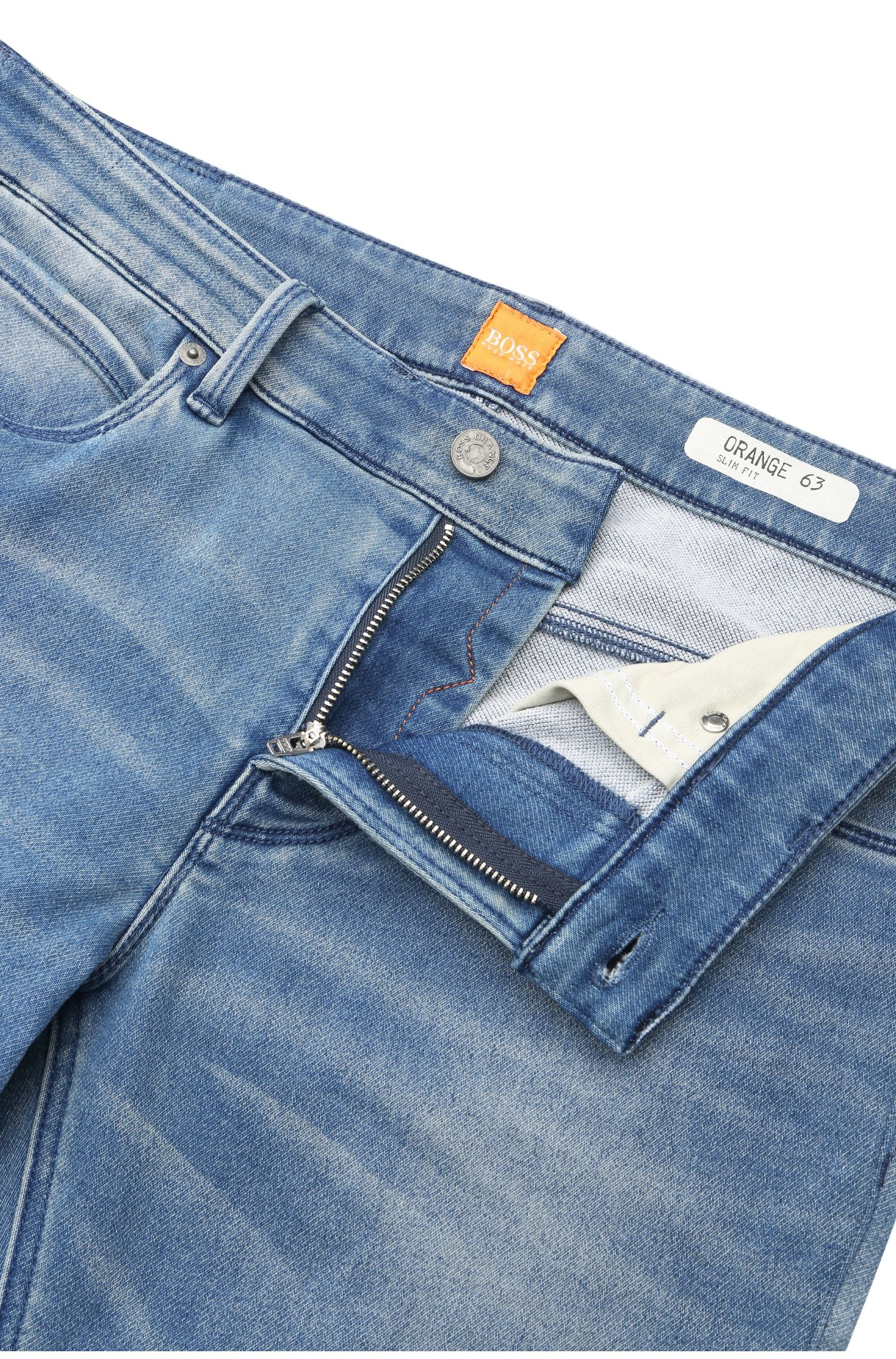 Jeans Slim Fit en coton mélangé extensible à l'aspect usé : « Orange63 »