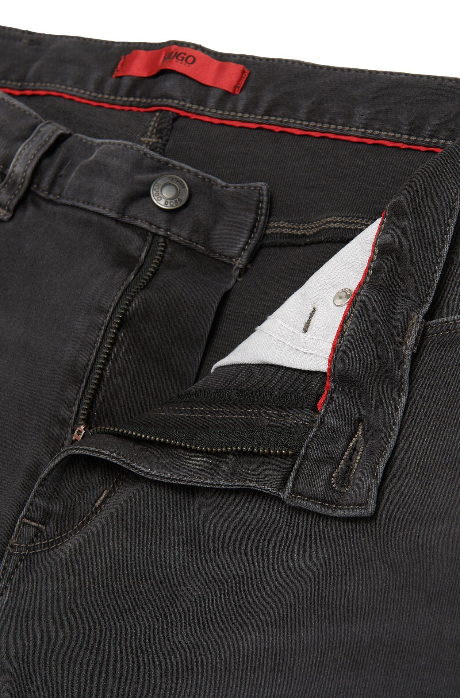 Skinny-Fit Jeans aus Baumwoll-Mix mit Used-Waschung: 'HUGO 734'