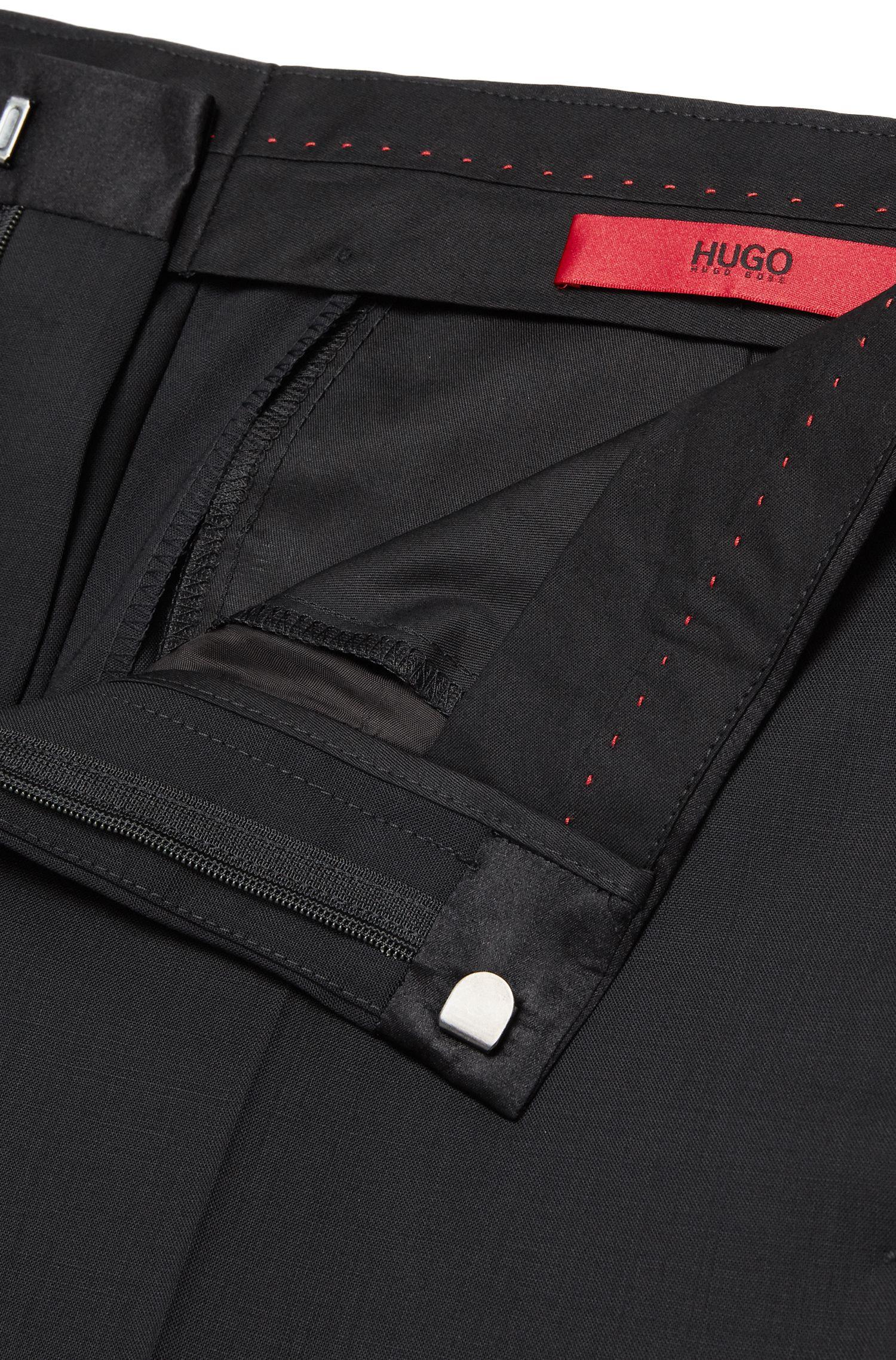 Effen, extra slim-fit broek van scheerwol met stretch: 'HetonS'
