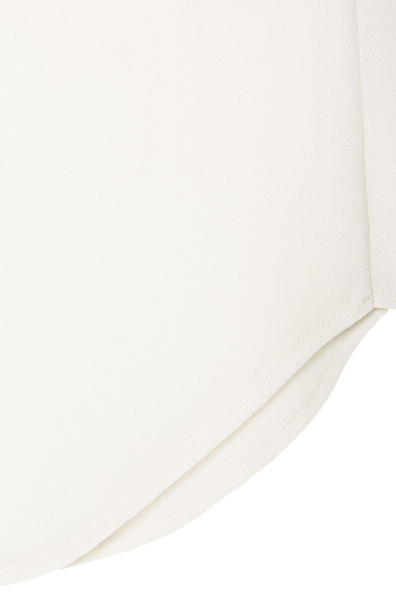 Haut légèrement évasé en mousseline travaillée en double épaisseur: «Isandar2»