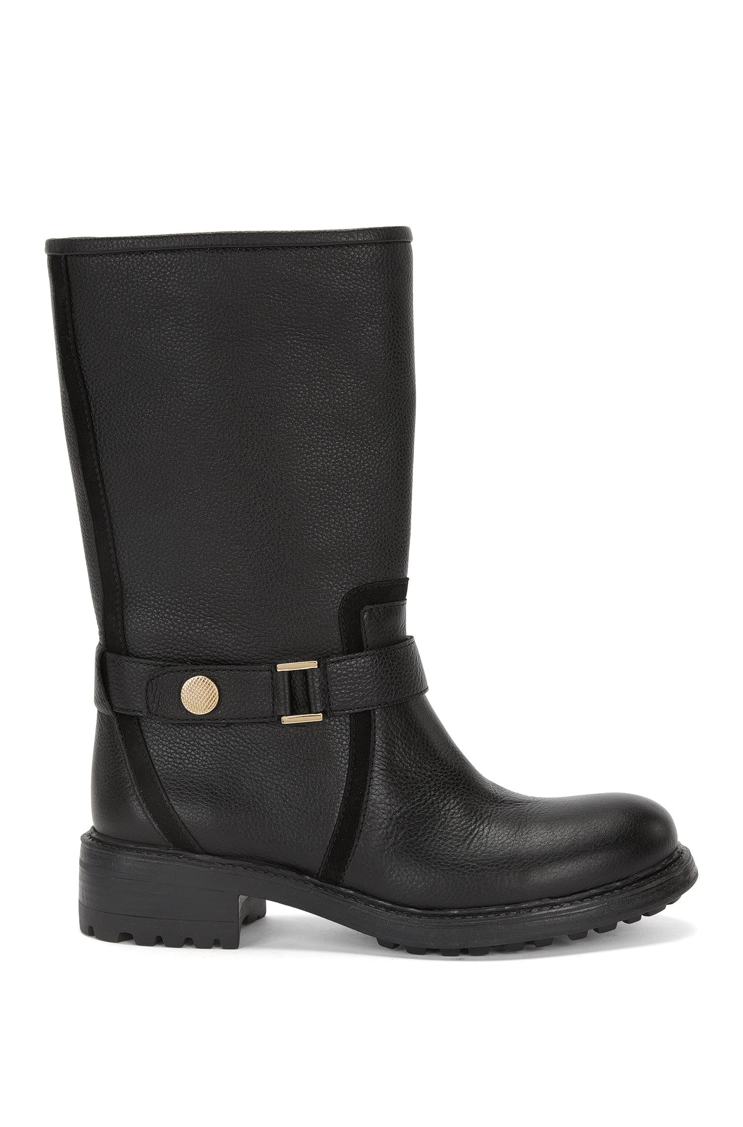 Leather boots with decorative tab element: 'Eduard-G'